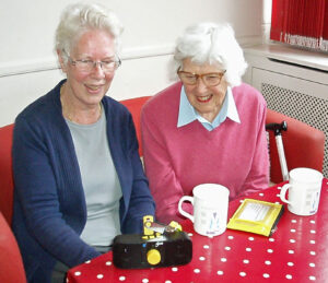 Hilary and Betty Listen to the latest edition of the Dorking Talking Newspaper